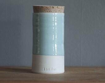 custom urn in straight shape with custom color, name, date. Modern custom urn. White porcelain with ice blue glaze