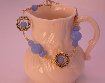 The Sutton Hoo Bracelet in Milky Blue and Gold Tone