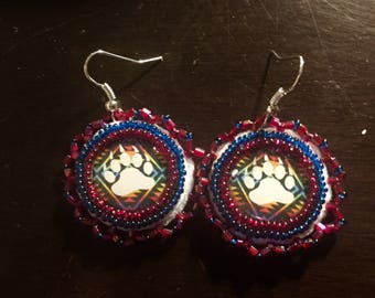 Beaded bear claw dangle earrings