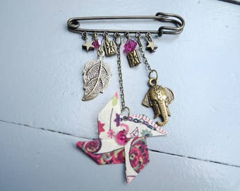 Bronze windmill charms and fabric brooch