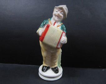 Accordion  player ceramic figurine
