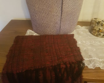This Herringbone Malty Red item can be a tablecloth runner, or a scarf. There are two. This one measures 43 inches x 13 inches.