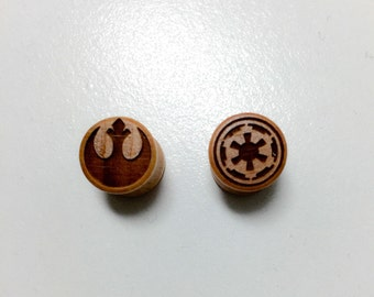Pair Rebel vs empire ear plugs