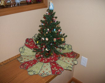 Reversible red and green small Christmas tree skirt. It is 25 inches round.