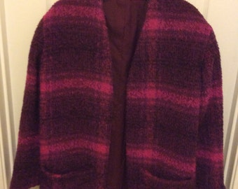 Woolen multicolor deep pink warm jacket, patch pockets, no buttons, collarless.