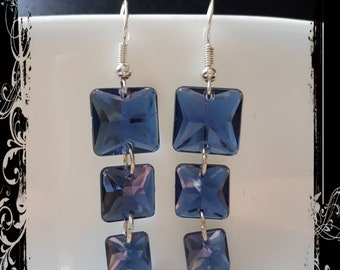 Blue button earrings with mirror like back.