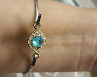 Fashion jewlery,  silver bracelet with blue / diamond rhinestone gold charm..