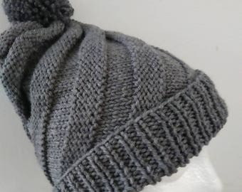 Hand Knitted Children Swirl hat with pompom fits age 6 to young Adult heather gray color