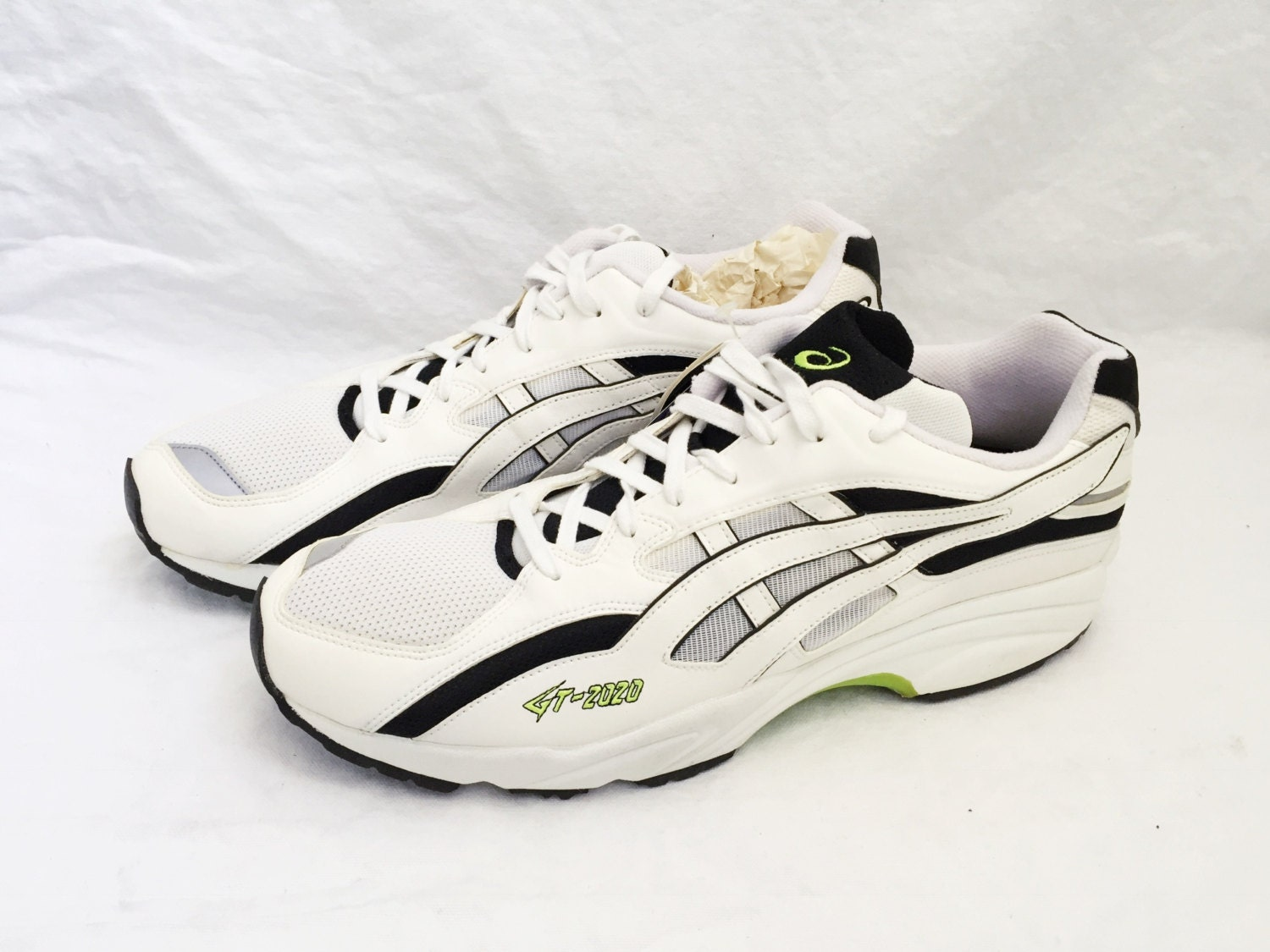 Description. 1997 asics running shoes.
