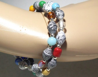 Memory Wire Bracelet with Black and White Handmade Paper Beads and an Assortment of Multi Colored Glass Beads