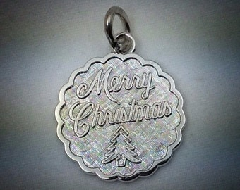 "Vintage ""Merry Christmas"" sterling silver charm."