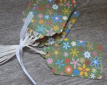20 large tags with flower motifs on green background
