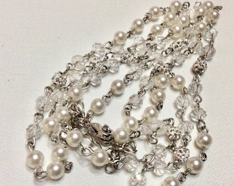 Deisgner signed Rmn faux pearl rhinestone beaded necklace.