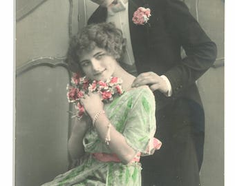 "Hand colored ""romantic"" postcard of couple. Hand tinted RPPC. German"
