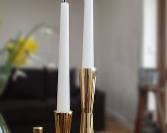 Beautiful candlesticks hand machined from solid brass bars and hand polished to make a stunning complement to your dining table