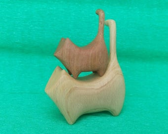 Wooden cats. Wooden carving statuettes of cats. The family of cats . Mother and child. Montessori waldorf toy.