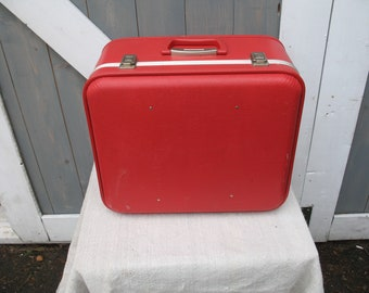 Red square shape suitcase. Travel luggage, for decoration.