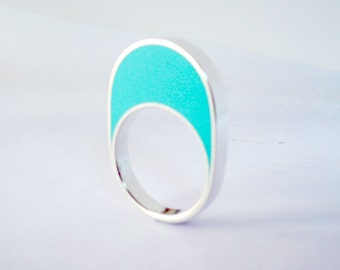 Handmade sterling silver and turquoise resin ring.