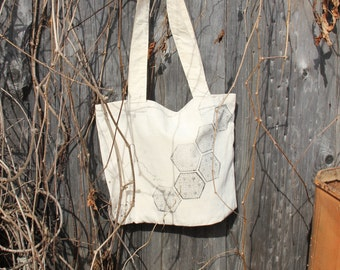 Bag made of natural cotton. Printed by hand with a wooden board. Exclusive ornament will help the mistress feel especially