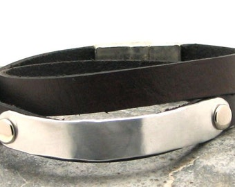 Men's leather bracelet. Black flat leather wrap men's bracelet with hammered metal work and silver plated magnetic clasp.