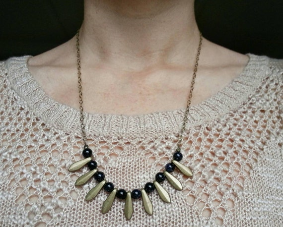 Blue goldstone with brass daggers on antique brass chain necklace