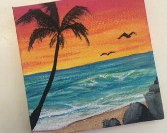 Small sunset beach painting.
