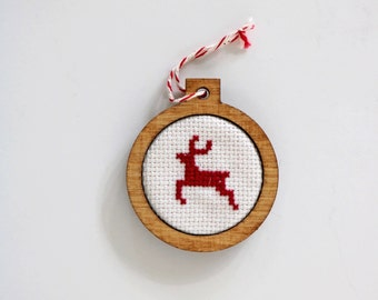 Cross stitch red reindeer holiday Christmas ornament in stained birch wood frame by Canadian Stitchery