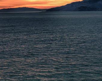 Man at the ocean at sunset