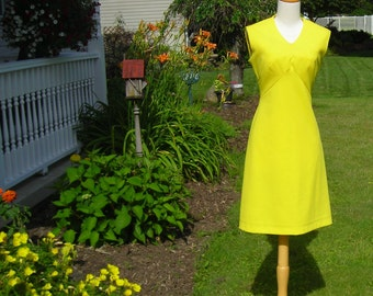 60's bright lemon yellow A-line shift dress, high rise inverted  V pieced waist to pointed bodice, sleeveless