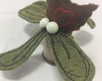 Tiny bird with mistletoe