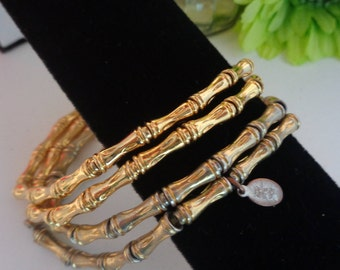 """Vintage Joan Rivers 4 Goldtone Bamboo Style Bracelets to be worn Together. The Bracelets Stretch and can be worn by an 8"""" wrist."""