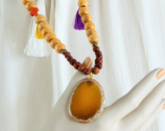 Bohemian necklace mustard yellow agate mounted on wood beads, carved boxwood, agate, glass, howlite cross beads, tassels.