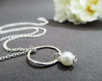 Sterling silver necklace with a hammered loop and freshwater pearl