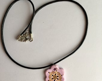 Handmade light pink flower necklace with pattern detail