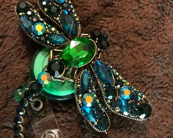 Green rhinestone dragonfly badge reel