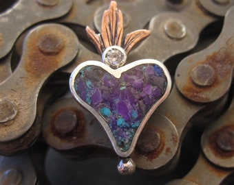 Southwestern Flaming heart pendant handmade in sterling silver and copper with purple sugilite stone inlay