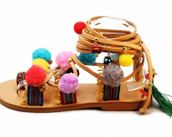 CARNIVAL - tie up gladiator pom pom leather sandals/ long laces pom pom sandals embellished with plenty charmy things boho style
