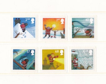 2004 Raymond Briggs Christmas Mint Unused Postage Stamps for letter art, Santa Claus, Father Xmas, snow, winter, presents, reindeer, chimney