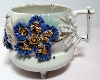 Footed White China Tea Cup with Blue Flowers and Raised Gold Leaf Home and Garden Kitchen and Dining Tableware Drinkware Coffee and Tea Cups