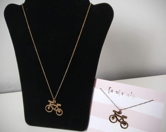 Antique gold effect mid-length necklace with bicycle pendant