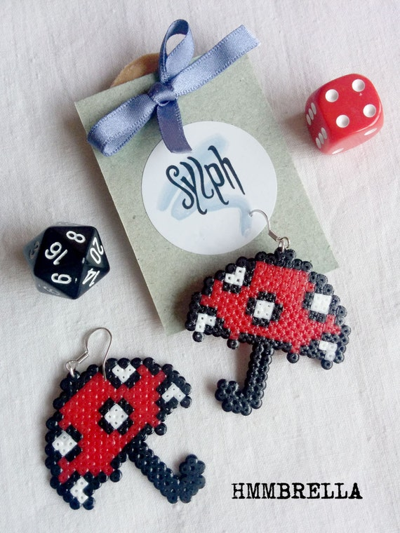 Geeky red pixelated umbrella earrings with white polkadots, perfect for rainy days and autumn weather