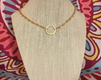 Gold circle in peach