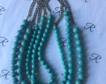 Turquoise multi layer necklace.