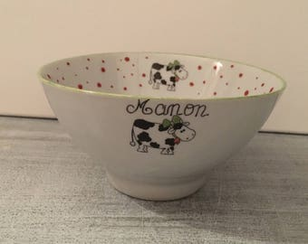 "Bowl with ""cow"" name, red polka dots and green border"