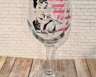 Cameo Wine Glass Collection, Audrey Hepburn as Holly Golightly from the movie Breakfast at Tiffany's, 20oz. stemmed wine glass with quote.
