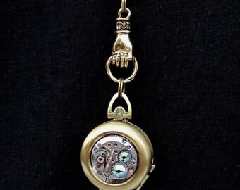 Locket - Steampunk jewelry Antique bronze - Hand holding Double locket green borealis Swarovski crystals - Watch parts - Pendant- Necklace