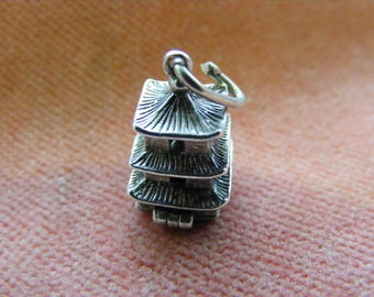 B) Vintage Sterling Silver Charm Pagoda opens to a Asian man