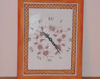Ceramic wall clock entirely decorated by hand.