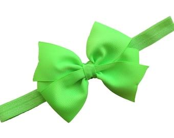 Lime green 3 inch pinwheel style bow on matching elastic headband