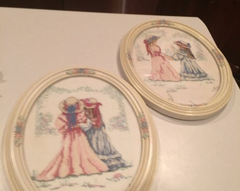 Vintage pair of needlepoint in vintage ivory and rose frame